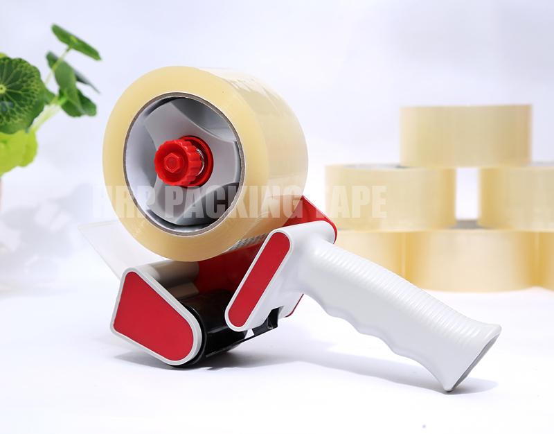 Tape dispenser for packing tape