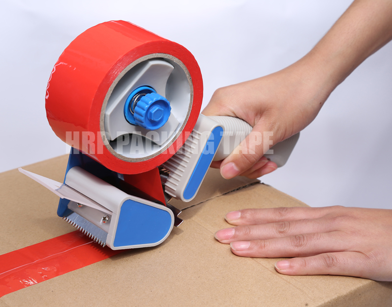 Shipping tape dispenser